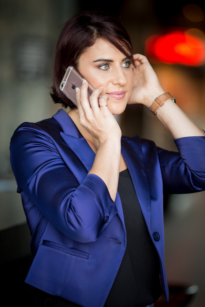 This branding photo of Maria shows her obviously intent on giving her undivided attention to the person on the other end of the phone.